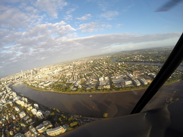 Sunset river helicopter scenic tour over Brisbane